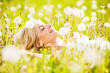 stock-photo-17524499-close-up-of-a-beautiful-young-woman-among-dandelions